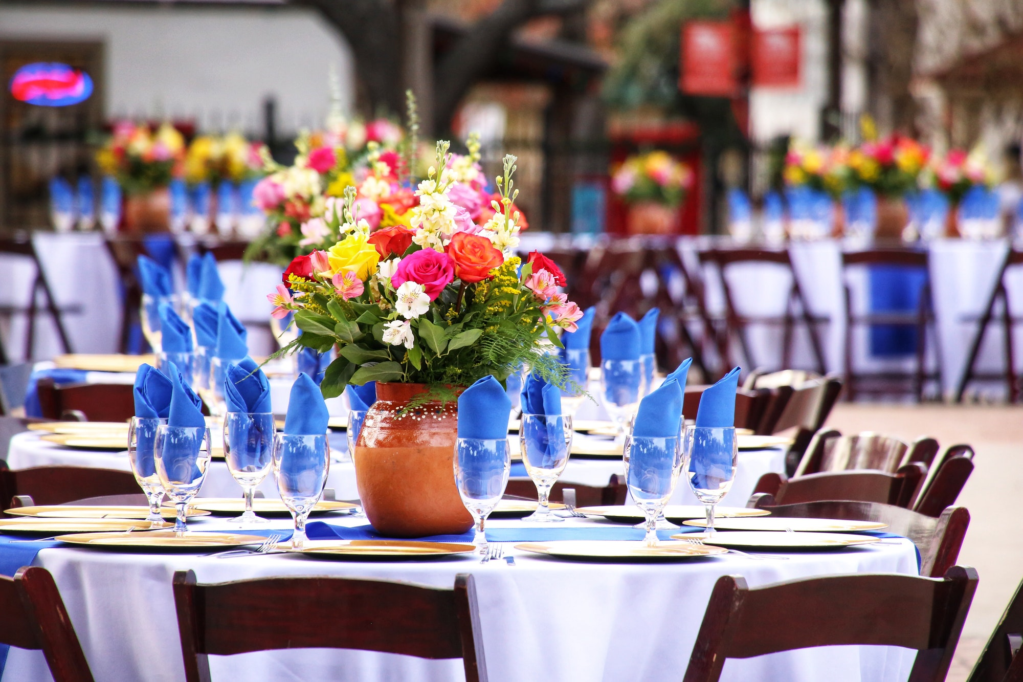 Beautiful table setting at an outdoor wedding venue.