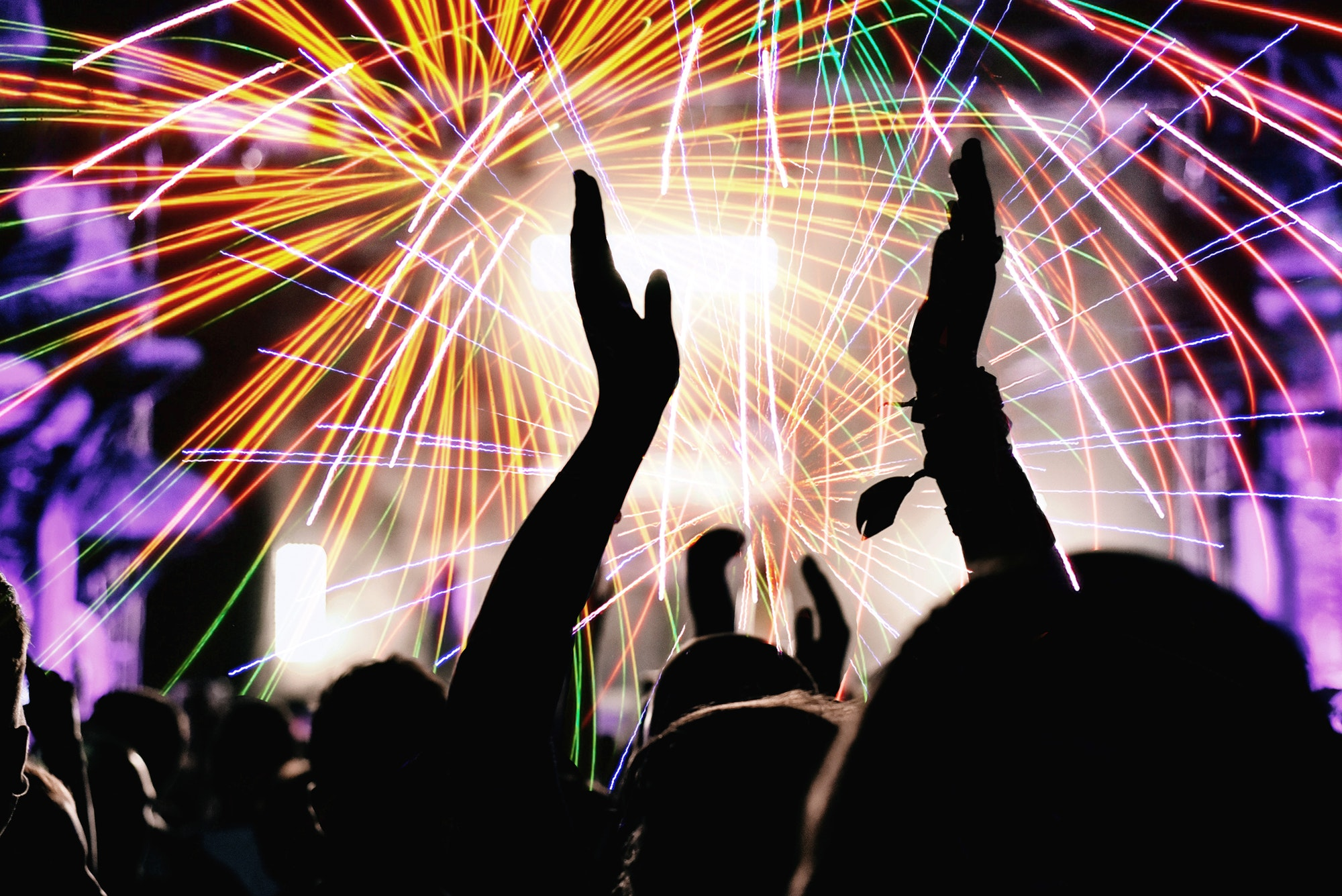 Cheering crowd and fireworks at New Year's Eve party